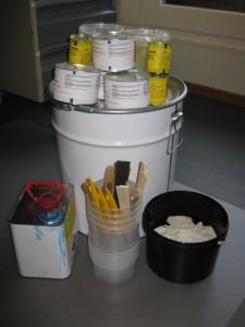 de materialen en gereedschappen benodigd voor het negatief